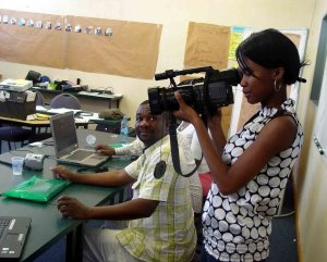 Maggie Nyaunda from CTV checks her equipment while Timothy Ncube from Bay TV looks on