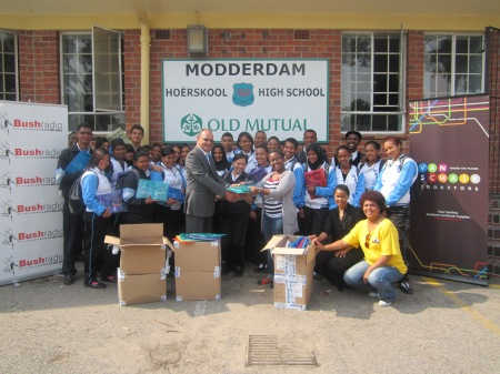 Bush Radio's, Lusanda Bill hand over the stationery to Modderdam High Principal, Mr Snyer