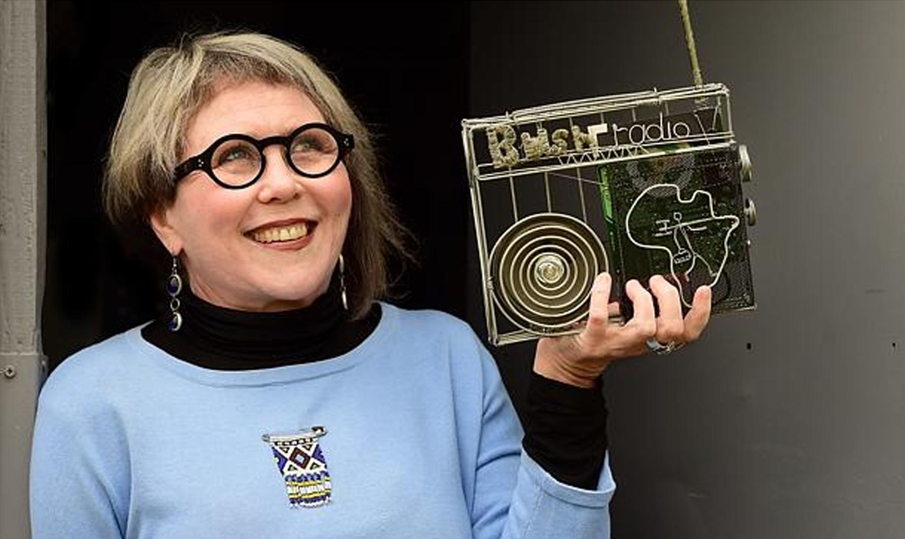 "Bushradio friend and radio activist Tracey Naughton with a Bush ""wire"" Radio"